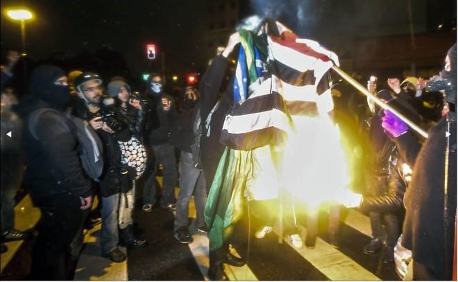 Bandeiras queimadas by Miguel Schincariol, AFP